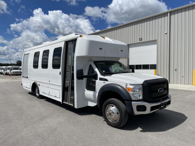 2012 Turtle Top Ford 12 Passenger Shuttle Bus Passenger side exterior front angle-U10475-1