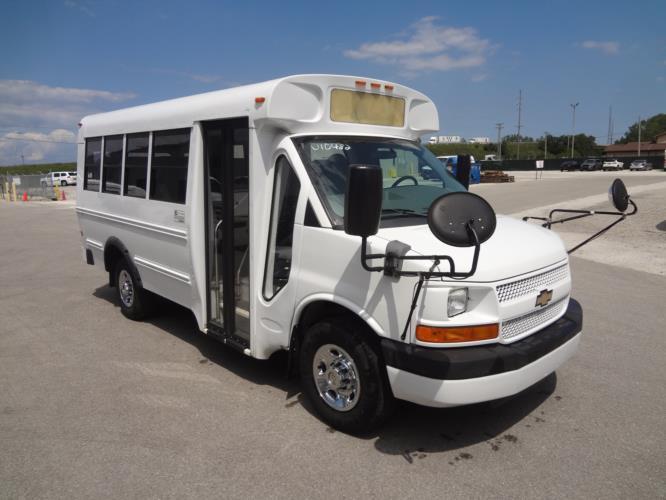 2013 Blue Bird Chevrolet 14 Passenger Child Care Bus Passenger side exterior front angle-U10482-1
