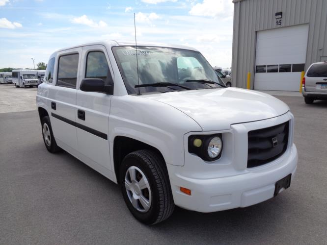 2014 Mobility Ventures 3 Passenger and 1 Wheelchair Van Passenger side exterior front angle-U10559-1