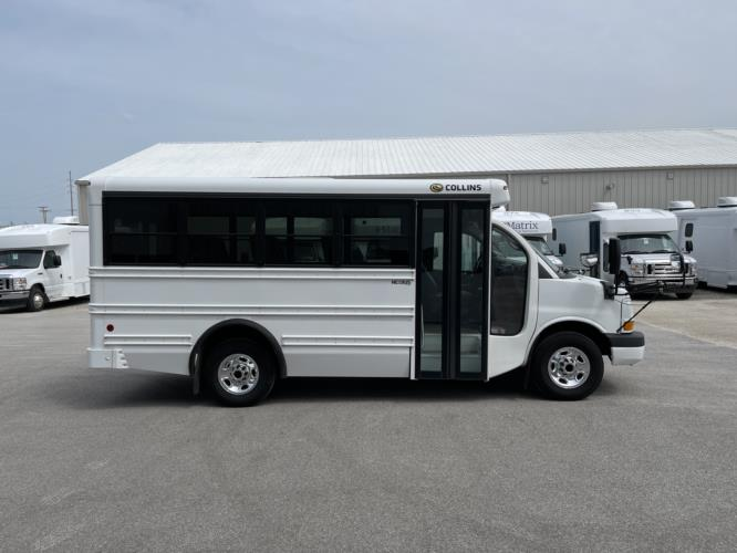 2013 Collins Chevrolet 14 Passenger Child Care Bus Driver side exterior front angle-U10625-2